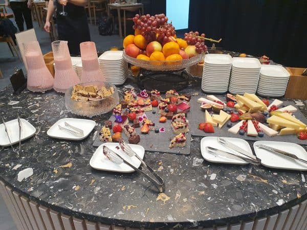 Cheese, fruit and sweets table in Finnair Platinum Wing
